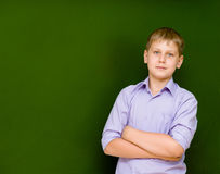 Portrait of young schoolboy near chalkboard Royalty Free Stock Photography