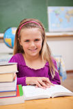 Portrait of young schoolgirl reading a book Royalty Free Stock Images