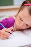 Portrait of a young schoolgirl writing Royalty Free Stock Photography