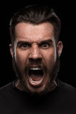 Portrait of young screaming man in studio Stock Photos