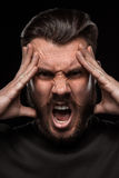 Portrait of young screaming man in studio Royalty Free Stock Photography
