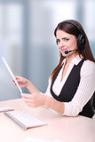 Portrait of young secretary with headset Royalty Free Stock Photos