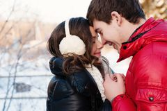 Portrait of young sensual couple in cold winter wather. Outdoor fashion portrait of young sensual couple in cold winter wather. love and kiss Stock Photography
