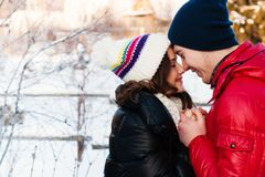 Portrait of young sensual couple in cold winter wather. Outdoor fashion portrait of young sensual couple in cold winter wather. love and kiss Stock Photo