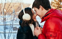 Portrait of young sensual couple in cold winter wather. Outdoor fashion portrait of young sensual couple in cold winter wather. love and kiss Royalty Free Stock Image