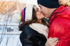 Portrait of young sensual couple in cold winter wather. Outdoor fashion portrait of young sensual couple in cold winter wather. love and kiss Stock Images