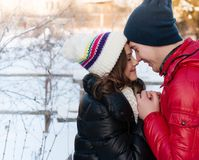 Portrait of young sensual couple in cold winter wather. Outdoor fashion portrait of young sensual couple in cold winter wather. love and kiss Royalty Free Stock Images