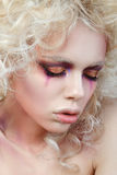 Portrait of young sensual woman with fashion make-up. Portrait of young sensual woman with blond curly hair and fashion clown make-up Royalty Free Stock Photo