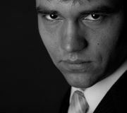 Portrait of a young serious businessman. Bw Portrait of a young serious businessman Royalty Free Stock Image