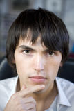 Portrait of young serious handsome man. Stock Photos