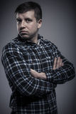 Portrait of young serious man with arms crossed Royalty Free Stock Photo