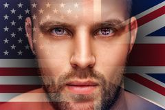 A portrait of a young serious man, in whose eyes is reflected the national flag royalty free stock image