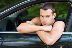 Portrait young serious men sits car Royalty Free Stock Photos