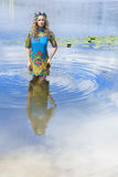 Portrait of young serious woman near the water Royalty Free Stock Image