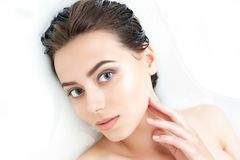 Portrait of woman taking spa bath. Skin beauty health care concept royalty free stock images