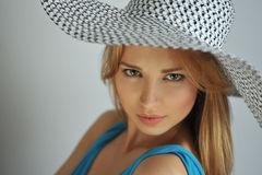 Portrait of young sexy blond girl wearing summer hat Royalty Free Stock Photo