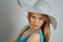 Portrait of young sexy blond girl wearing summer hat Stock Photography