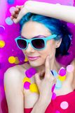 Portrait of young female in bathtub with pink water. Portrait of young pretty female girl adult woman fashion luxury model with blue hair relaxing wearing royalty free stock image