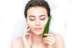 Portrait of woman taking spa bath. Skin beauty health care concept Royalty Free Stock Image