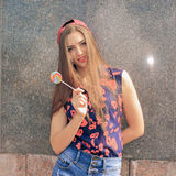 Portrait of young sexy funny fashion girl with red lollipop. Stock Photos