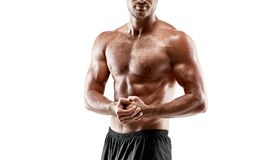 Portrait young handsome man of strong athlete`s body with bare torso. Posing on white studio background royalty free stock photo