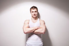 Portrait of a young sexy muscular man in underwear. Looking at camera against white wall Stock Photos