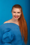 Portrait of a young sexy redhead girl in a blue hat Royalty Free Stock Images