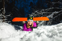 Portrait of the young snowboarder in the winter forest Royalty Free Stock Photo