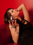 Portrait of young sexy woman. With a glass of whiskey Stock Images