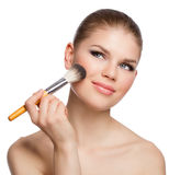 Portrait of young sexy woman applying blusher Stock Image