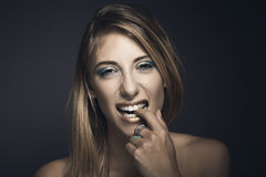 Portrait of young sexy woman biting her fingers Stock Photo
