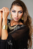 Portrait of the young sexy woman in black tunic Arabic Royalty Free Stock Photo