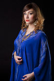 Portrait of the young sexy woman in blue tunic Arabic Stock Photography
