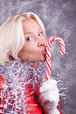 Portrait of young sexy woman kissing lollipop. Portrait of young sexy blonde kissing her Christmas candy Stock Images