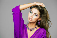 Portrait of the young sexy woman in purple  tunic Arabic Royalty Free Stock Images