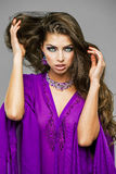 Portrait of the young sexy woman in purple  tunic Arabic Royalty Free Stock Photography