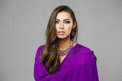 Portrait of the young sexy woman in purple  tunic Arabic Royalty Free Stock Image