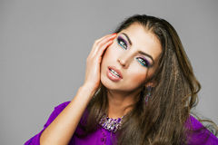 Portrait of the young sexy woman in purple  tunic Arabic Royalty Free Stock Photos