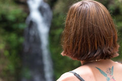 Portrait of young sexy woman in the rainforest of tropical Bali island, Indonesia. Waterfall on a background. Rare view. Stock Photo