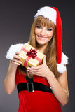 Portrait of young, sexy woman Santa with gift boxes Stock Photography