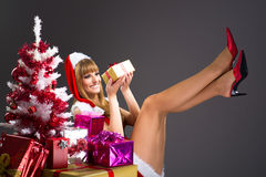 Portrait of young, sexy woman Santa with gift boxes Stock Images