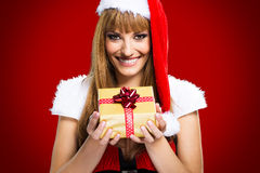 Portrait of young, sexy woman Santa with gift boxes Royalty Free Stock Photos
