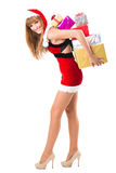 Portrait of young, sexy woman Santa with gift boxes Stock Photos