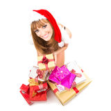 Portrait of young, sexy woman Santa with gift boxes Royalty Free Stock Photography