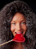Portrait of young sexy woman sucking lollipop. Portrait of young sexy woman eating Christmas candy Royalty Free Stock Photo
