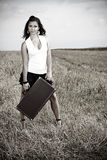 Portrait of a young woman with suitcase Royalty Free Stock Photography