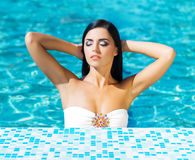 Portrait of a young and sexy woman in a swimming pool Stock Photography