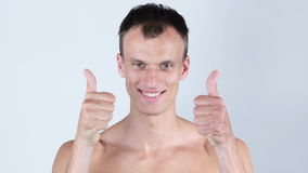 Portrait of young shirtless man shows thumbs up with both hands. Talented Man, Creative Designer, freelancer, employee, worker stock video footage