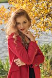 Portrait of a young shy coy girl in autumn royalty free stock photo