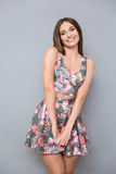 Portrait of young shy pretty girl in summer floral suit Stock Image